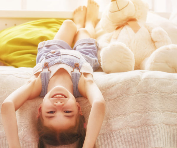funny girl plays at home. girl having fun and resting. recreation and entertainment at home.